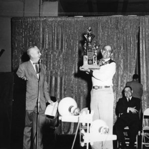 L Shaw receiving award.jpg